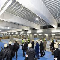 Narita International Airport's new terminal for low cost carriers, scheduled to open in April, was built using low-cost construction methods such leaving pipes exposed on the ceiling. | KYODO