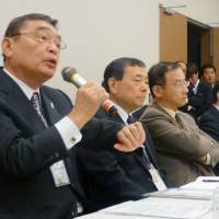 NHK Chairman Katsuto Momii takes a grilling from Democratic Party of Japan lawmakers in Tokyo on Wednesday. | KYODO