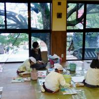 Children draw pictures at the Iwaya Nursery School in Kyoto in November. | KYODO