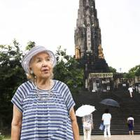 Ikuko Yasuda, one of the local residents who helped prepare the land for the erection of Peace Tower in Heiwadai Park in the city of Miyazaki in 1940, visits the site again last August. | KYODO