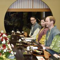 Britain's Prince William and Prime Minister Shinzo Abe enjoy a light-hearted moment as they have dinner at a traditional Japanese inn in Koriyama, Fukushima Prefecture, on Saturday. | KYODO