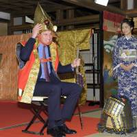 Britain's Prince William tries out a samurai outfit as actress Mao Inoue looks on at NHK's studios in Tokyo on Saturday. | AFP-JIJI