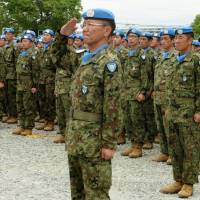 Ground Self-Defense Force personnel return from South Sudan to their base in Itami, Hyogo Prefecture, last June. | KYODO
