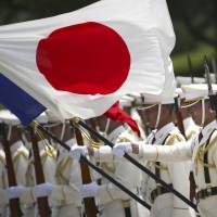 A Self-Defense Forces honor guard prepares to be inspected by French Defense Minister Jean-Yves Le Drian at the Defense Ministry in Tokyo on July 29, 2014. | AP