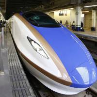 The new Hokuriku Shinkansen, set to debut between Tokyo and Kanazawa, arrives on March 14 at JR Omiya Station in Saitama Prefecture for a test run. | KYODO