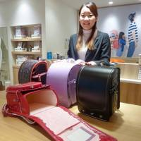 Sayuri Inoue of Seiban, a maker of 'randoseru' backpacks used by elementary schoolchildren, says its products have become popular with American and European tourists. | KYODO