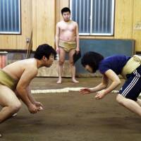 Amateur women wrestlers take on sumo's big boys
