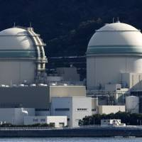 The No. 3 (left) and No. 4 reactors at Kansai Electric Power Co.'s Takahama plant in Fukui Prefecture have been cleared for safety by the Nuclear Regulation Authority. | BLOOMBERG