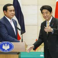 Prime Minister Shinzo Abe and Thai Prime Minister Prayuth Chan-ocha wrap up a joint news conference in Tokyo on Monday. | KYODO