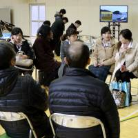 Residents of Kamaishi, Iwate Prefecture, take shelter in the gymnasium of a primary school Tuesday morning following the tremor. Sirens sounded and people fled low-lying areas. | KYODO