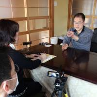 Tsunami-hit city library compiles victims' memoirs in English