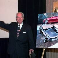 Yutaka Katayama, the 'father of the Z,' waves to the media after introducing Nissan's new Z car concept during a news conference in Dearborn, Michigan in 1998. Katayama, who built the Z sports car into a powerful global brand in the 1970s, died Thursday, his son said. He was 105. | AP