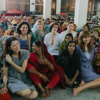 Fair share: People Tree founder Safia Minney (second row back, third from left), Dean Newcombe and other volunteers visit garment workers at the Thanapara Swallows Development Society in Rajshahi, Bangladesh, in 2013. | AIKA MIYAKE