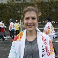 Sarah Costeira, Consulate staff, 24 (French): This is my first marathon, and I trained and have run today with my friends just for the challenge of doing it. Unfortunately we got separated during the race so I am looking for them now. My next will be in Bintan (in Indonesia).