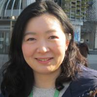 Riko K., Document clerk, 29 (Japanese): Um, it could be Brad Pitt because he's a cool guy. His face, his eyes — he's a dream date. For me it might be impossible, but he could come here and take me to a fancy restaurant!