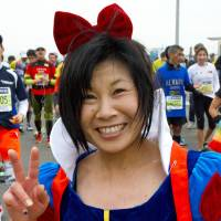 Harumi Kanbayashi, Lady of leisure, 48 (Japanese): It is my third time to do the Tokyo Marathon. I really enjoy it and I live in Saitama, so it's not far. I wanted to be Cinderella today, but instead I came as Snow White. I'm an Asian beauty, even if my hair is messy now.