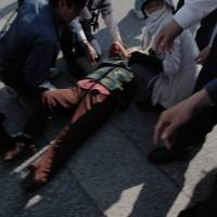 On Nov. 20, 85-year-old Fumiko Shimabukuro — a survivor of the Battle of Okinawa — was knocked unconscious while attempting to block a construction truck entering the new base site in the Henoko district of Nago, Okinawa. | TOMOYUKI TOYOZATO