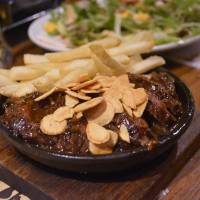 Beef festival: Wild steak topped with roasted garlic, served with fries | J.J. O'DONOGHUE