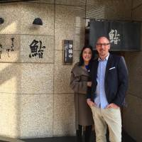 For the love of good food: Stephanie Robesky and Jeff Hull have their photo taken outside the sushi restaurant Sukiyabashi  Jiro in Roppongi.  | COURTESY OF STEPHANIE ROBESKY