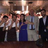 Gourmet lovers: Stephanie Robesky (center) with Jeff Hull (second from right), Chef Rene Redzepi (second from left) and other members of staff at Noma in Tokyo.    COURTESY OF STEPHANIE ROBESKY
