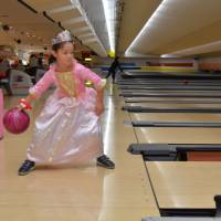 Bowled over: Tokyo Dome City's bowling alley has gutter bumpers to help kids build confidence bowling. | JASON JENKINS