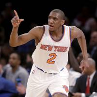 Chalk it up: New York's Langston Galloway reacts after scoring against the Lakers on Sunday. | AP