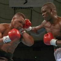 Historic upset: Buster Douglas connects with a right hand to the head of Mike Tyson during their world heavyweight title fight at Tokyo Dome on Feb. 11, 1990. Douglas won by a knockout in the 10th round in a stunning result. | AP