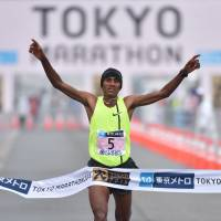 No one close: Ethiopia's Endeshaw Negesse breaks the tape to win the Tokyo Marathon on Sunday. Negesse won in a time of 2 hours, 6 minutes. | AFP-JIJI