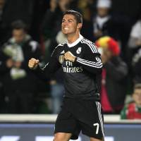 Back in black: Real Madrid's Cristiano Ronaldo celebrates after scoring against Elche on Sunday in the Spanish League. Real beat Elche 2-0. | AP