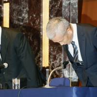 Benesse CEO Eiko Harada (right) apologizes in Tokyo in July 2014. | KYODO