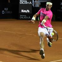 Not there yet: Rafael Nadal plays a shot from Italy's Fabio Fognini in their semifinal match at the Rio Open on Saturday. Fognini won 1-6, 6-2, 7-5. | AFP-JIJI