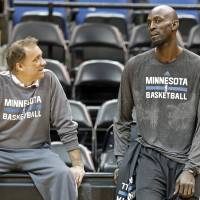 Together again: Kevin Garnett (right) talks to head coach Flip Saunders on Tuesday after his first practice since returning to the Minnesota Timberwolves. | AP