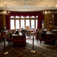 Movie set: An exhibit shows how the library of the mansion would have appeared during World War II at the Bletchley Park museum in Buckinghamshire, England. | AP