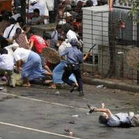Line of duty: Journalist Kenji Nagai (foreground) was killed while documenting a demonstration in Yangon in 2007. | REUTERS