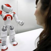 Smart money: Mitsubishi UFJ Financial Group plans to become the first bank in the world to use Nao robots at its branches. | BLOOMBERG