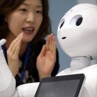 Nestle Japan wants to utilize SoftBank's Pepper robots to sell its coffee machines at up to 1,000 outlets by the end of the year. | BLOOMBERG