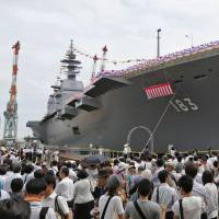 History, built from steel: Spectators mingle at the naming ceremony of the Izumo, Japan's first helicopter carrier, constructed in 2013 for the Maritime Self-Defense Force. Izumo is a major character in the 'Kojiki,' an important historical text, recently re-translated into English by Gustav Heldt. | KYODO
