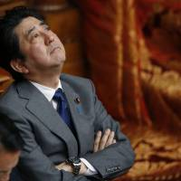 Better days ahead: Prime Minister Shinzo Abe takes a moment to reflect during a Diet session. | AP