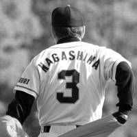 Ultimate honor: Giants manager Shigeo Nagashima sheds his jacket, revealing his No. 3, on the first day of spring camp on Feb. 1, 2000. | KYODO