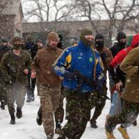Croatian volunteers fighting alongside Ukrainian army; Serb counterparts helping pro-Russian rebels