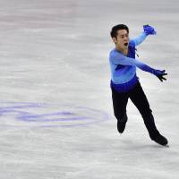 Reach out: Daisuke Murakami performs during the men's free program in Seoul on Saturday. | AFP-JIJI