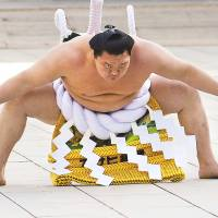 Man of the people: Hakuho scheduled to be given the equivalent of Japan's People's Honor Award in his native Mongolia. | REUTERS