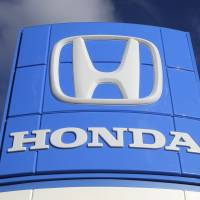 A sign at a Honda dealership in Miami Lakes, Fla. Honda announced on Thursday that it is launching an unprecedented U.S. ad campaign urging owners to get vehicles repaired if they have been recalled to fix defective air bags. | AP