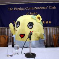 Funassyi, the popular unofficial mascot of Funabashi, Chiba Prefecture, greets reporters at the Foreign Correspondents' Club of Japan in Tokyo on Thursday. Known for its bizarre squeaks and jumps, the mascot said it would be making more appearances overseas. | AP