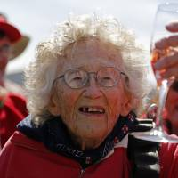 South African woman fetes 100th birthday with a skydive; shark cage next
