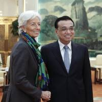International Monetary Fund Managing Director Christine Lagarde meets with Chinese Premier Li Keqiang in Beijing on Monday. Lagarde said Sunday she welcomes Beijing's efforts to boost investment outside China.   AP