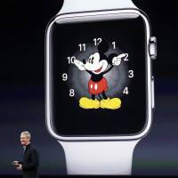 Apple CEO Tim Cook introduces the Apple Watch during ann Apple event in San Francisco on Monday. | REUTERS