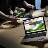 Apple's new MacBooks are displayed following an Apple event in San Francisco on Monday. | REUTERS