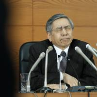 Bank of Japan Gov. Haruhiko Kuroda reacts at a news conference at the bank's Tokyo headquarters in December. | BLOOMBERG