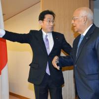 Foreign Minister Fumio Kishida escorts Ricardo Cabrisas, vice president of Cuba's Council of Ministers, at the Foreign Ministry in Tokyo on Monday. | KYODO